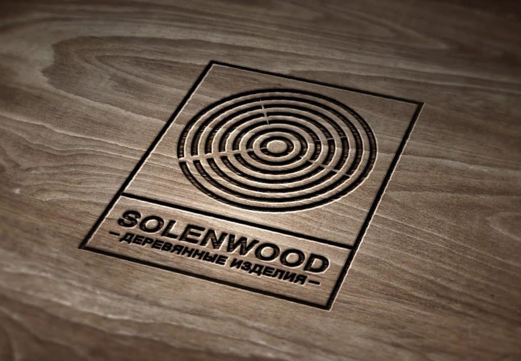 логотип на компании а древесине